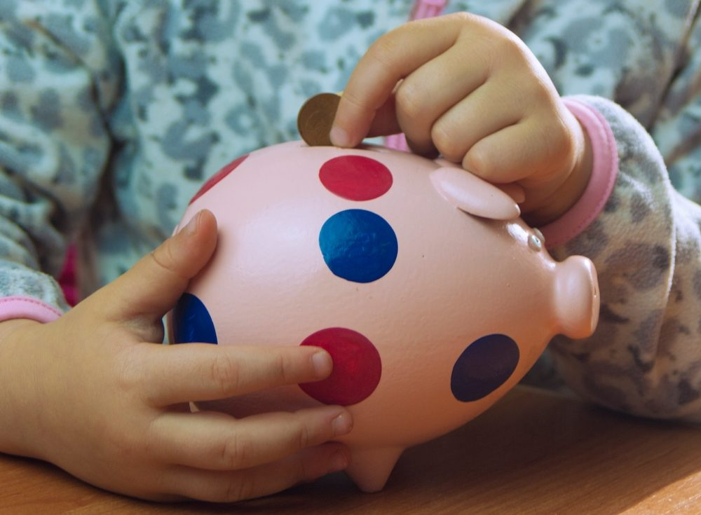 personal  Home Page little girl holding piggy bank family budget hands woman pig bank inside savings interest wealth t20 JYrvyl